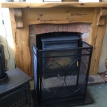 Square Rustic fireplace and Burley Stove